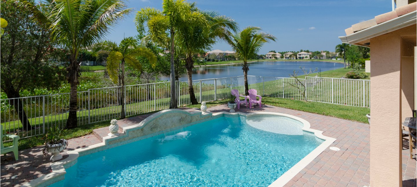 This is a beautiful aerial view of the pool and lake at 7054 Via Leonardo, Lake Worth, Fl